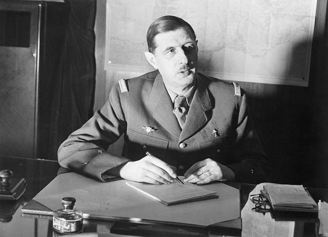 800px-Commander_of_Free_French_Forces_General_Charles_de_Gaulle_seated_at_his_desk_in_London_during_the_Second_World_War._D1973